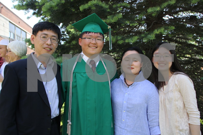Pictured here from left to right is: Gisoo Kang, Min Sung Kang, So  Sung Lee, and  Min Hee Kang. They were attending the Saint Edmond High School Graduation held on  Sunday, May 22, 2016 at the Saint Edmond High School in Fort Dodge.