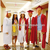 Aryah Parker (from left), Lauren Bulak, Olivia Orlandi, Ty Rybarczyk and Cam McDonald get ready for commencement ceremonies Friday night, when Hall High School handed out diplomas to 70 graduating seniors.