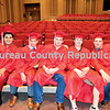 Hall graduates William Zaragoza (from left), Jonathan Hurtado, Jacob Manfredini, Dylan Vizzon and Gary Merkel pose in their caps and gowns.