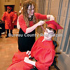 Jessica Strouss helps Spencer Sipe get ready for graduation ceremonies at Hall High.