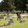 MIKE ELSWICK/Muskogee Phoenix<br /> Tonie Allen, left and Taraji Cooper walk among graves at Greenhill Cemetery on Thursday afternoon looking for graves of military veterans.