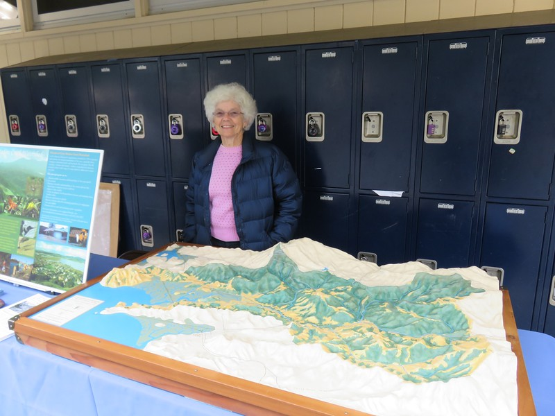 Sandy Guldman with relief map of CM Creek watershed