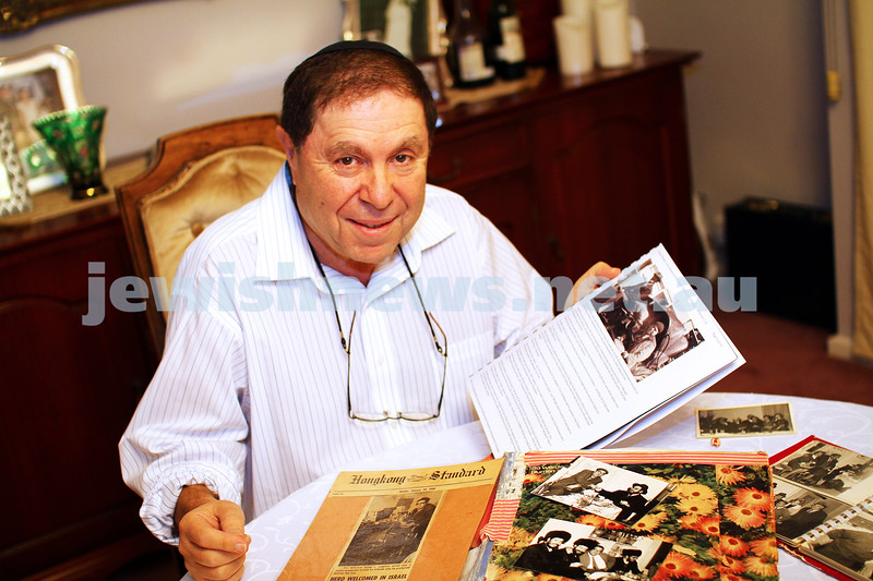 29-4-14. Willy Eckstein with photos of his father Yona. photo: peter haskin