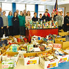 "Students and staff at Parker Middle School in Chelmsford some of the food they collected during the school's 10th annual ""SouperBowl"" Food Drive in February."