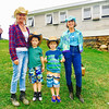 Strongwater Farm in Tewksbury held a County and Western Harvest Hoedown fundraiser in October, where, from Left, Director of Operations Patti Lessard of Chelmsford, Bryson and Austin Lessard of Lunenburg, and board Chairwoman Diana Lane of Melrose wore their best duds.