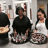 Chef John Rork of Nashua, with his interns, Rayhel and Iris, both House of Hope residents and part of the house's Learn to Work (L2W) program, whip up some delicious delights at the House of Hope's grand opening of its residence at 520 Fletcher St., in Lowell in July.