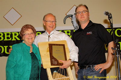 Shirley Hartman and Tyler from Big West Country radio, Drayton Valley, present the Lifetime Achievement award to Alfie Myhre - Alberta's Men & Women of Country Music 2014