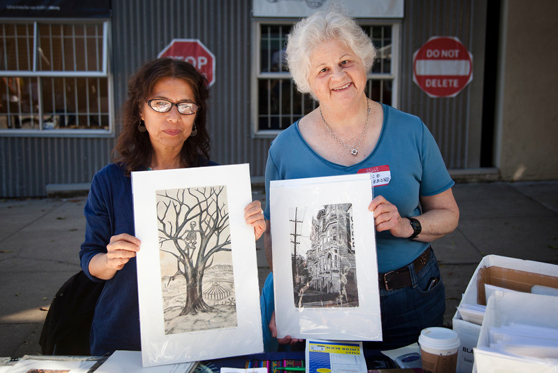 Gloria Morales, SOL Press and friend Alice Gibbons show off their favorite etchings during the 2013 SFCB Roadworks Street Fair on September 29, 2013.