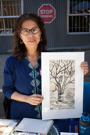 Gloria Morales, ARist-Printmaker, SOL Press shows her intricate etchings during the 2013 SFCB Roadworks Street Fair on September 29, 2013.