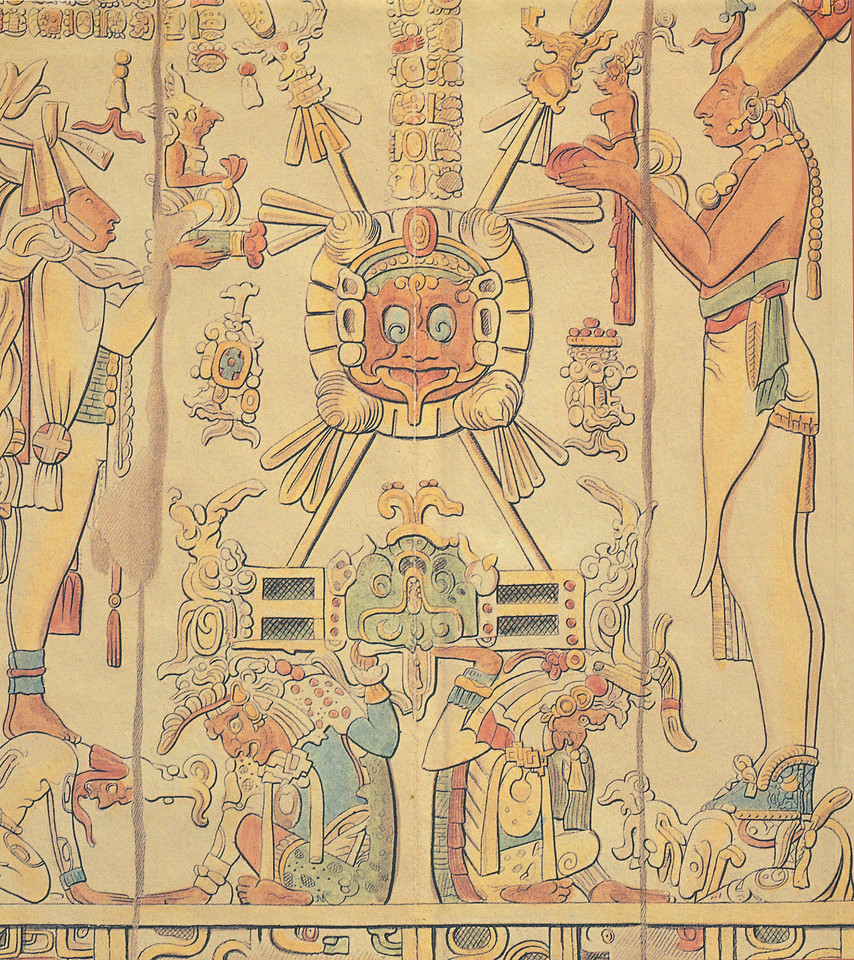 "Panel from The Temple of the Sun. Both text and image rest on a double-headed band decorated with earth symbols. The smaller person at left stands on a kneeling figure who is decorated with marks that identify supernaturals. The left-most person holds a Jester god/personified flint figurine that rests on a tiny bench. The person on the right side of the panel stands atop a kneeling Supernatural decorated with ""k'uhul"" (god) symbols. This larger person offers a K'awiil figurine. At center, God L (left) and an unidentified god hold aloft a large bench embellished with jaguar and serpent motifs. Atop the bench are two crossed lances and a shield decorated with the face Of G-iii. Glyphs recording supernatural locations flank the shield."