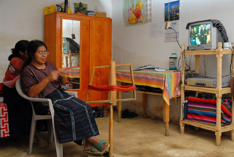 Maria Ajop Chovon, preparing thread for weaving in her family's home in Quiacasiguan, Nahuala.