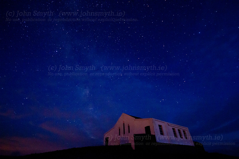 The church on the summit of Croagh Patrick in Co. Mayo, pictured under a starry sky. The faint trace of the Milky Way can be seenover the church.