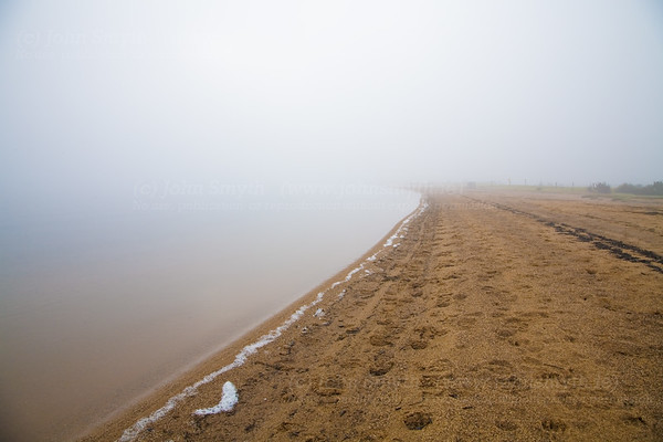 Early morning fog on the sandy beach at Lough Nafooey in Co. Mayo, Ireland.