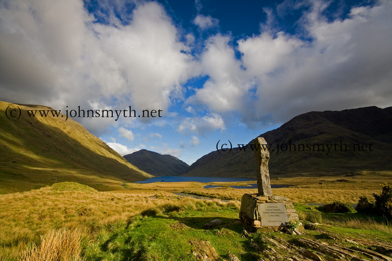 A cross overlooking Doo Lough in Co. Mayo. On the right of the picture is Mweelrea and on the left are the Sheeffry hills. Beyod the other end of Doo Lough is Aasleagh Falls, Leenane and Killary fjord.
