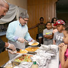 The kids at the New Life Spanish Christian Church summer program had their lunch served up by Pastor Dennis Bradley and Fitchburg Mayor Steven DiNatale on Thursday. SENTINEL & ENTERPRISE/JOHN LOVE