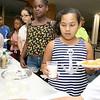 Jarieliz Santana, 8, gets her lunch at the New Life Spanish Christian Church summer program on Thursday. SENTINEL & ENTERPRISE/JOHN LOVE