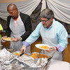 The kids at the New Life Spanish Christian Church summer program had their lunch served up by Janet Payne, Pastor Dennis Bradley and Fitchburg Mayor Steven DiNatale on Thursday. SENTINEL & ENTERPRISE/JOHN LOVE