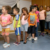 The kids at the New Life Spanish Christian Church summer program line up for lunch that was being served by Fitchburg Mayor Steven DiNatale on Thursday. SENTINEL & ENTERPRISE/JOHN LOVE