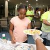 Jezabeth Almonte, 8, gets her lunch at the New Life Spanish Christian Church summer program on Thursday. SENTINEL & ENTERPRISE/JOHN LOVE