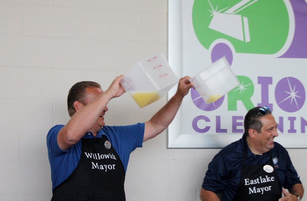 . Kristi Garabrandt - The News-Herald <br> Willowick Mayor Rich Regovich protest the final decision of a tie after the lemon squeeze battle him and Eastlake Mayor Dennis Morley based on the amount of juice in the containers.