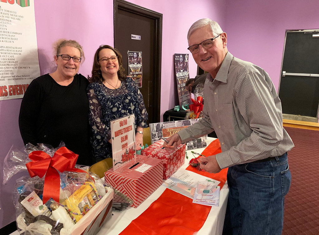. Kristen Ross Sitcawich of Lowell and Susan Britain of New Hampshire sell raffle tickets to Steve O�Neil of Westford