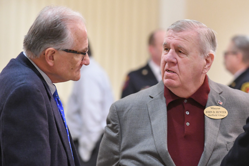 . Lake Mayor Greg Zilka, left, and Sheffield Village Mayor John D. Hunter talk prior to the start of the North Coast Chamber of Commerce Mayor�s Lunch.