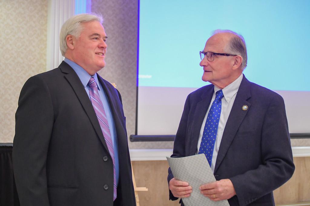. Sheffield Lake Mayor Dennis Bring, left, and Avon Lake Mayor Greg Zilka talk prior to the start of the North Coast Chamber of Commerce Mayor�s Lunch.