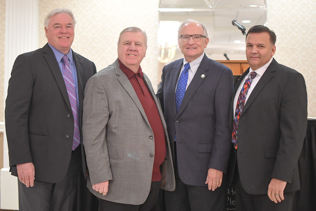 . Mayors, from left, Dennis Bring, of Sheffield Lake; John D. Hunter, of Sheffield Village; Greg Zilka, of Avon Lake; and Bryan Jensen, of Avon take a moment for photos prior to the start of the North Coast Chamber of Commerce Mayor�s Lunch.