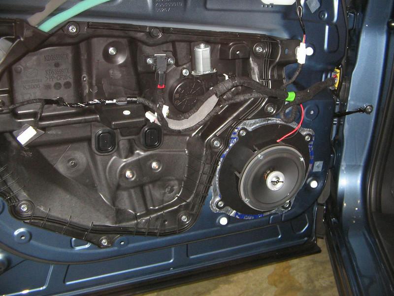 "Aftermarket speaker,    <a href=""http://www.car-speaker-adapters.com/items.php?id=SAK102""> Speaker adapter</a> ,   and   <a href=""http://www.car-speaker-adapters.com/sounddeadener.php""> Fatmat Sound Deadener</a>     from Car-Speaker-Adapters.com installed on door"