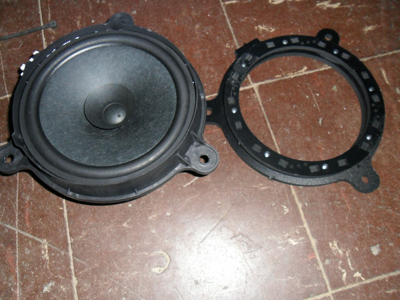 """Factory speaker next to the adapter  from  <a href=""""http://www.car-speaker-adapters.com/items.php?id=SAK112""""> Car-Speaker-Adapters.com</a>       I think you could get away with using a pretty thick speaker, since the adapter is considerably thinner than the factory speaker."""
