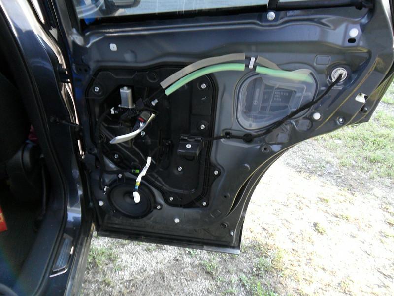 The passenger side factory speaker.