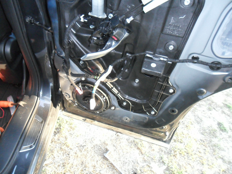Passenger side door with the new speaker installed. The red wire is the ground on the factory harness.