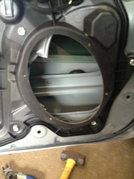 Factory speaker removed from door.  Door sheet metal modified to allow clearance for aftermarket speaker