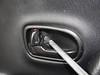Door handle bezel screw to be removed