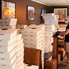 BEN GARVER — THE BERKSHIRE EAGLE<br /> A server prepares take out boxes in the seating booths at Mazzeo's Ristorante in Pittsfield, Tuesday, May 19, 2020. Mazzeo's Ristorante had to reinvent their business during the COVID-19 outbreak to accommodate safety measures and takeout, converting dining space to their evolving system. The take out business is thriving and they have been able to keep their staff employed.