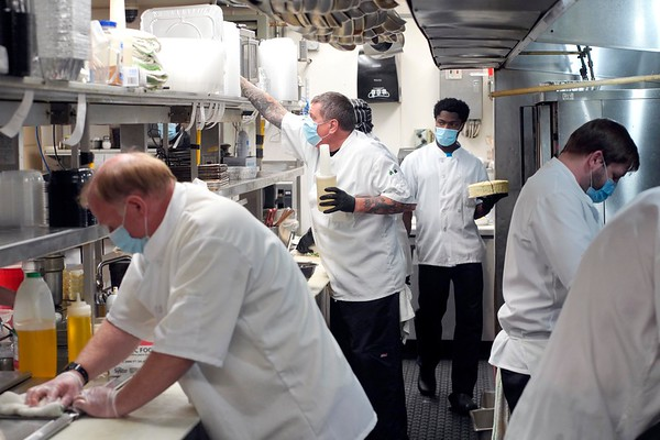 BEN GARVER — THE BERKSHIRE EAGLE<br /> The kitchen crew at Mazzeo's Ristorante in Pittsfield prepares dozens of take out orders, Tuesday, May 19, 2020. Mazzeo's Ristorante had to reinvent their business during the COVID-19 outbreak to accommodate safety measures and takeout, converting dining space to their evolving system. The take out business is thriving and they have been able to keep their staff employed.