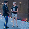 The daughter of a Vietnam veteran talks with an active duty officer at the candlelight vigil at the Vietnam Veterans Memorial Wall on Aug. 31.