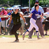 CAROLINE BONNIVIER SNYDER -- THE BERKSHIRE EAGLE<br /> McCann's Kailey Vanuni looks back to home plate after taking a lead off of first base during the game against Turners Falls held at Sortino Field at UMass on Saturday morning.