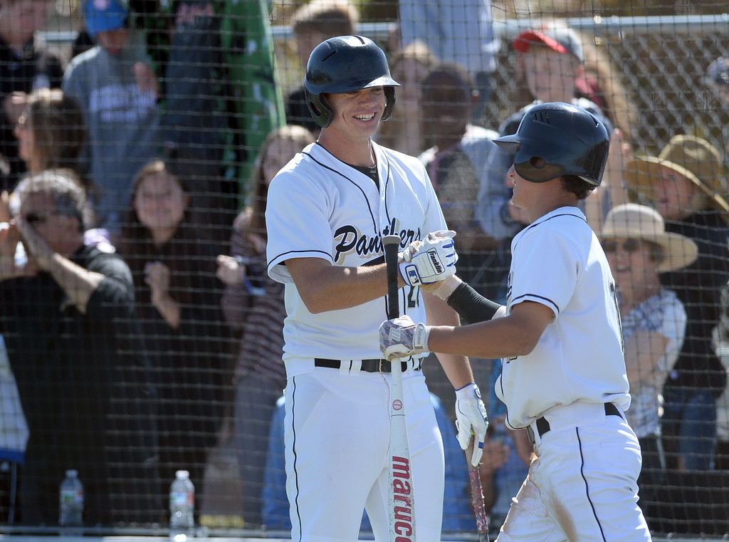 . Peninsula\'sJake McKenna (26) and Michael Fuhrman (10) celebrate as they run-up four runs on Warren in the first inning in a CIF Southern Section Division 3 baseball playoff game Thursday, May 18, 2017, Rolling Hills Estates, CA.  Peninsula won 6-2. (Photo by Steve McCrank, Daily Breeze/SCNG)