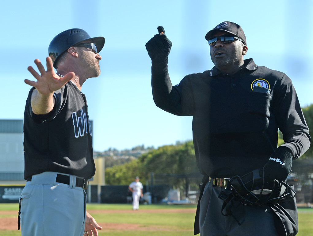. Warren coach Scott Pearson argues with head umpire after the ejection of two coaches in a game against Peninsula which Warren disputed many calls in a CIF Southern Section Division 3 baseball playoff game Thursday, May 18, 2017, Rolling Hills Estates, CA.  Peninsula won 6-2. (Photo by Steve McCrank, Daily Breeze/SCNG)