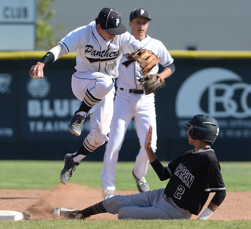 . Peninsula\'s Michael Fuhrman (10) lepas out of the way after forcing out Warren\'s Johnny Gonzalez (2) at second in a CIF Southern Section Division 3 baseball playoff game Thursday, May 18, 2017, Rolling Hills Estates, CA.  Peninsula won 6-2. (Photo by Steve McCrank, Daily Breeze/SCNG)