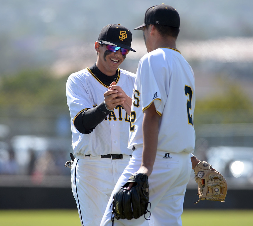 . San Pedro\'s Isaiah Bumgarner (3) fist bumps pitcher David Barraza (2) after getting out an inning and holding University scoreless in a first round game of Los Angeles City Section Division 1 baseball playoffs Tuesday, May 16, 2017, San Pedro, CA. (Photo by Steve McCrank, Daily Breeze/SCNG)