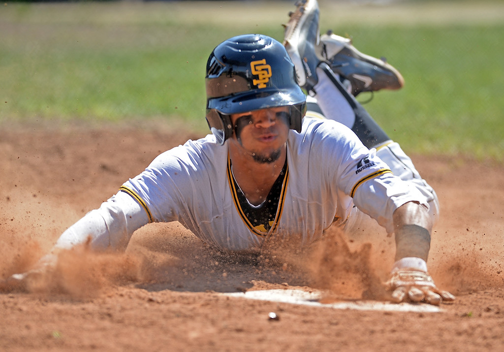 . San Pedro\'s Noah Ford (10) slides into home against University for the first run of the day in a first round game of Los Angeles City Section Division 1 baseball playoffs Tuesday, May 16, 2017, San Pedro, CA. (Photo by Steve McCrank, Daily Breeze/SCNG)