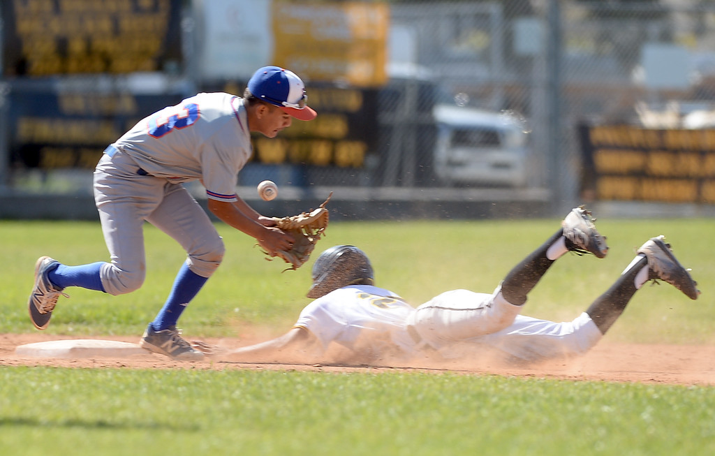 . San Pedro\'s Fabian Cervantes (27) slides into second as University\'s Luis Lopez (13) mishandles the ball in a first round game of Los Angeles City Section Division 1 baseball playoffs Tuesday, May 16, 2017, San Pedro, CA. (Photo by Steve McCrank, Daily Breeze/SCNG)