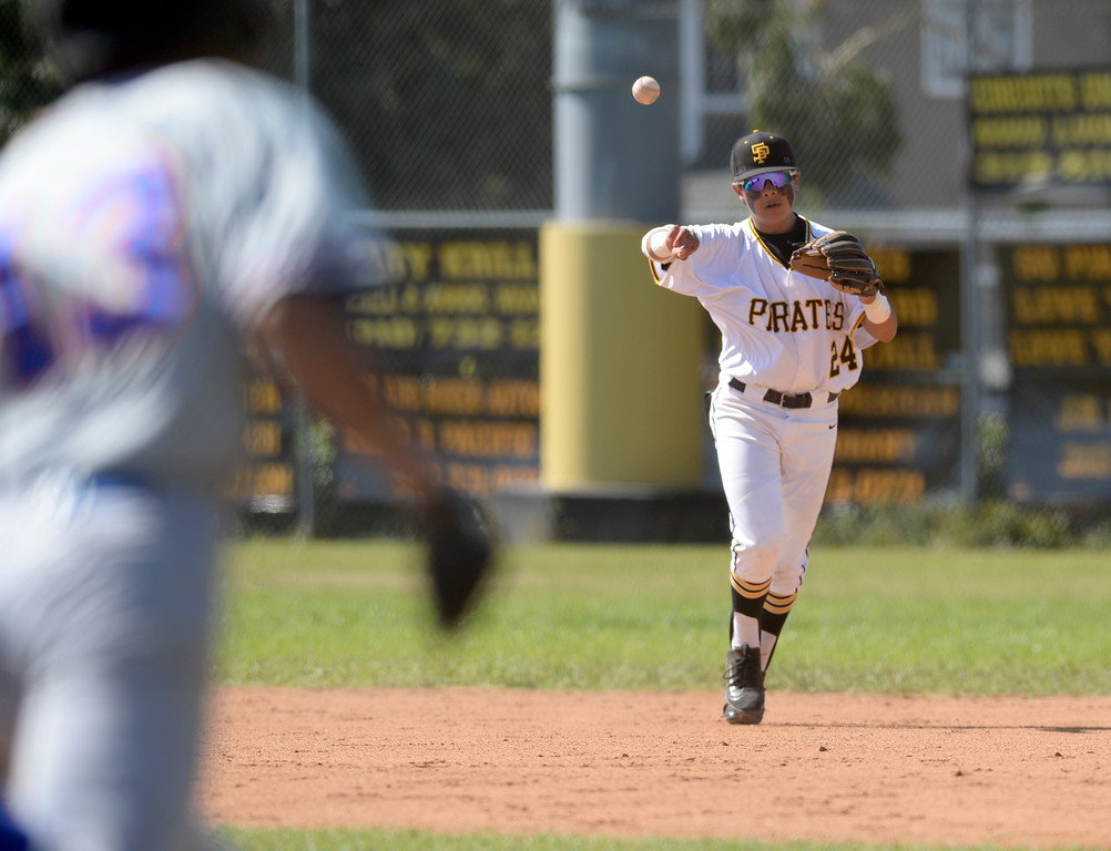 . San Pedro\'s Joshua Duarte (24) makes the play to first for an out on University\'s Luis Lopez (13) in a first round game of Los Angeles City Section Division 1 baseball playoffs Tuesday, May 16, 2017, San Pedro, CA. (Photo by Steve McCrank, Daily Breeze/SCNG)