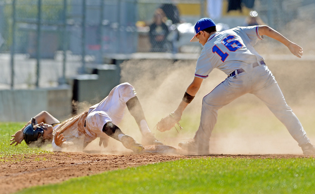 . San Pedro\'s Ryan Zamudio (20) was able to slide around a tag from University\'s Lewis Shepett (16) at third in a first round game of Los Angeles City Section Division 1 baseball playoffs Tuesday, May 16, 2017, San Pedro, CA. (Photo by Steve McCrank, Daily Breeze/SCNG)