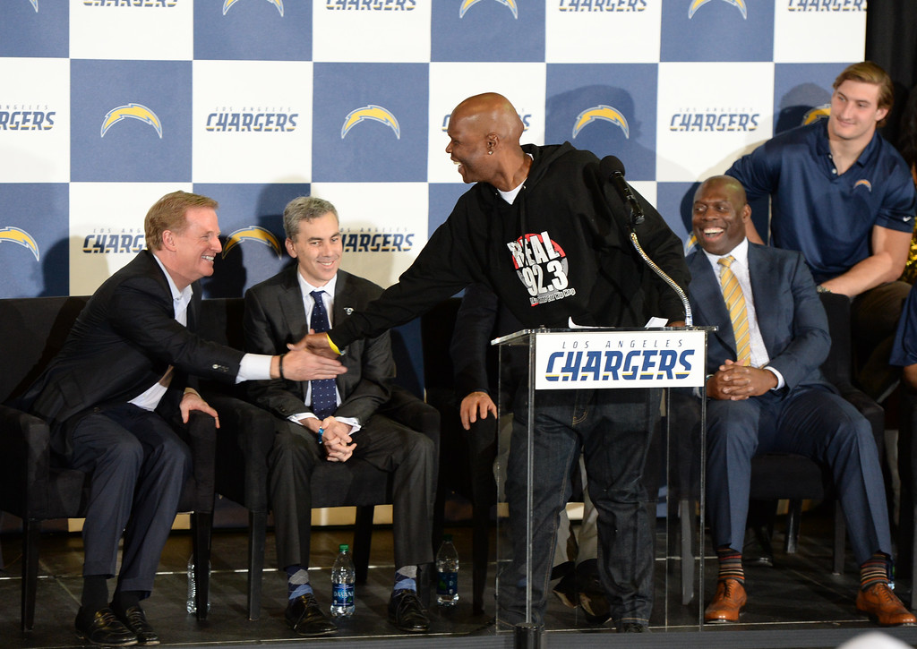 . Popular radio DJ Big Boy jokes with NFL Commissioner Roger Goodell about getting season tickets during a ceremony that was held at the Forum to welcome the Los Angeles Chargers back Wednesday, January 18, 2017, Inglewood, CA. On stage were Chargers players including, front from left: coach Anthony Lynn and quarterback Philip Rivers. Rear row: Joey Bosa, Melvin Gordon, Jason Verrett, and Brandon Mebane. Also in attendance was NFL Commissioner Roger Goodell and Chargers Chairman Dean Spanos.  Photo by Steve McCrank, Daily Breeze/SCNG