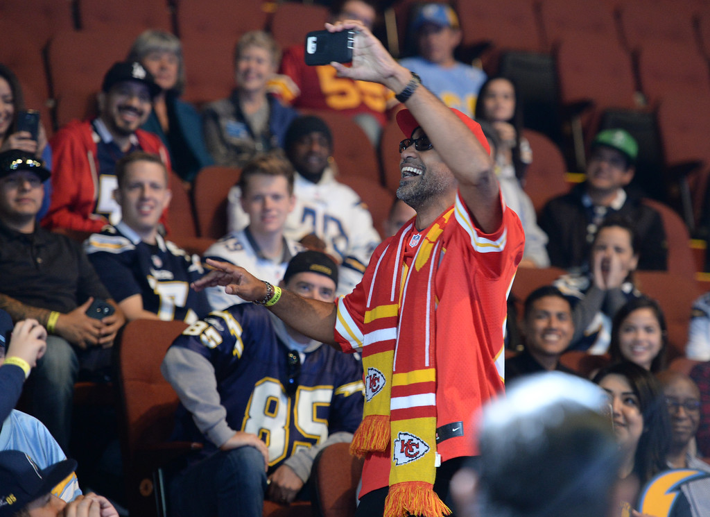 . A ceremony was held at the Forum to welcome the Los Angeles Chargers back Wednesday, January 18, 2017, Inglewood, CA. A fan dressed in Kansas City Chiefs gear jokes with the Chargers fans.  In attendance was NFL Commissioner Roger Goodell, Chargers Chairman Dean Spanos,  quarterback Philip Rivers, coach Anthony Lynn and many others. Photo by Steve McCrank, Daily Breeze/SCNG