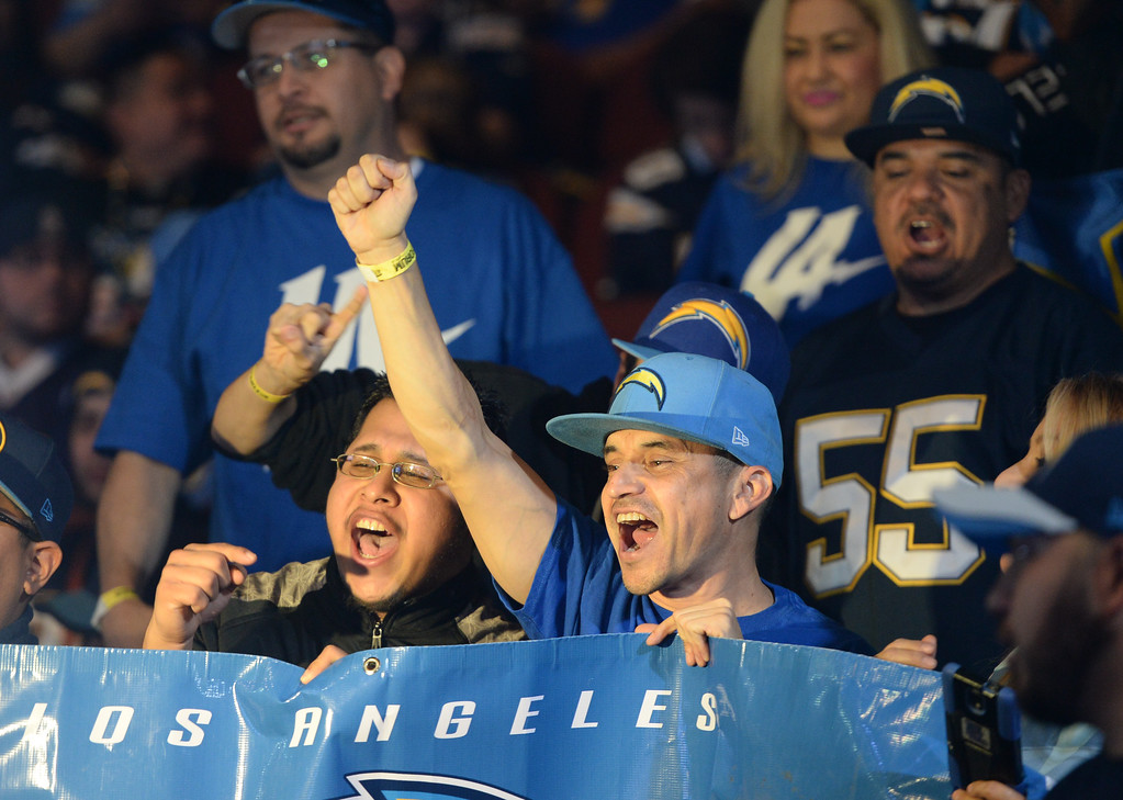 . Fans cheer during a ceremony that was held at the Forum to welcome the Los Angeles Chargers back Wednesday, January 18, 2017, Inglewood, CA.   In attendance was NFL Commissioner Roger Goodell, Chargers Chairman Dean Spanos,  quarterback Philip Rivers, coach Anthony Lynn and many others. Photo by Steve McCrank, Daily Breeze/SCNG