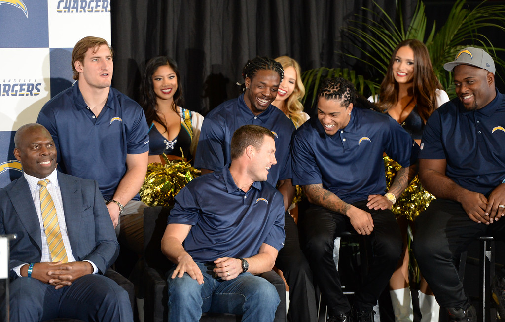 . A ceremony was held at the Forum to welcome the Los Angeles Chargers back Wednesday, January 18, 2017, Inglewood, CA. On stage were Chargers players including, front from left: coach Anthony Lynn and quarterback Philip Rivers. Rear row: Joey Bosa, Melvin Gordon, Jason Verrett, and Brandon Mebane. Also in attendance was NFL Commissioner Roger Goodell and Chargers Chairman Dean Spanos.  Photo by Steve McCrank, Daily Breeze/SCNG